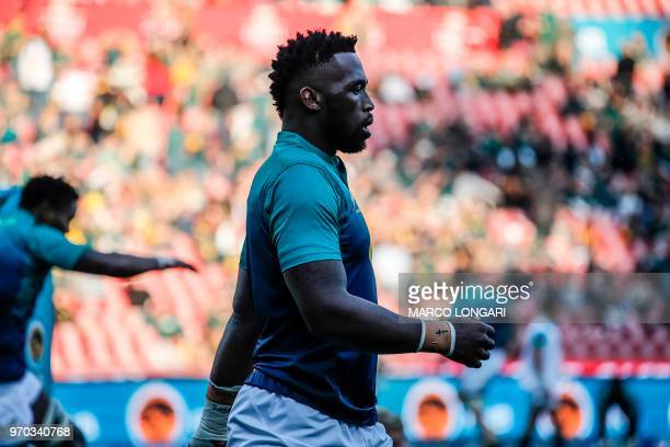 South Africa's flanker and captain Siya Kolisi warms up ahead of the first rugby union Test match between SouthAfrica and England at the Emirates...
