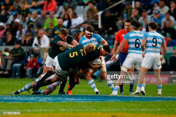 South Africa's flanker Francois Louw charges with the ball helped by South Africa's lock PieterSteph du Toit and South Africa's hooker Malcolm Marx...