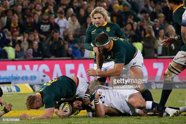South Africa's flanker Jean-Luc du Preez is tackled by England's prop Joe Marler during the second test match between South Africa and England at the...