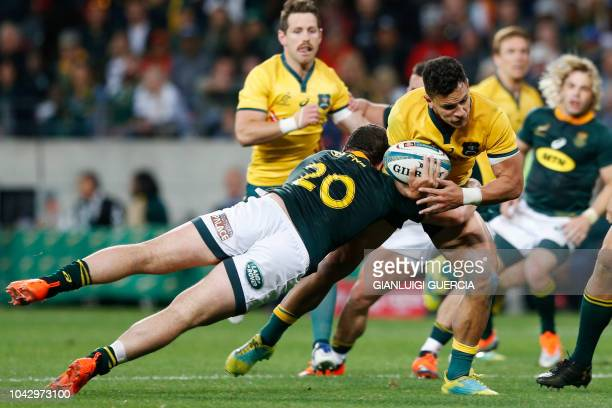 South Africa's flanker Marco van Staden tackles Australia's centre Matt Toomua during the Rugby Championship match between South Africa and Australia...