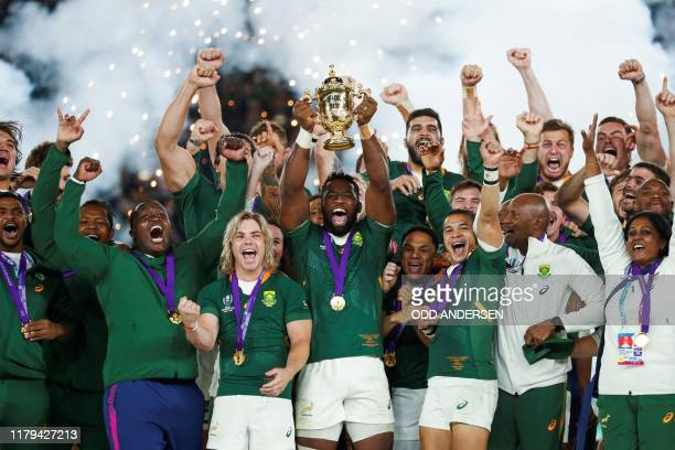 South Africa's flanker Siya Kolisi lifts the Webb Ellis Cup as they celebrate winning the Japan 2019 Rugby World Cup final match between England and...