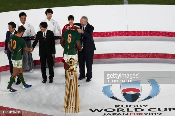 South Africa's flanker Siya Kolisi receives a medal from World Rugby chairman Bill Beaumont after winning the Japan 2019 Rugby World Cup final match...