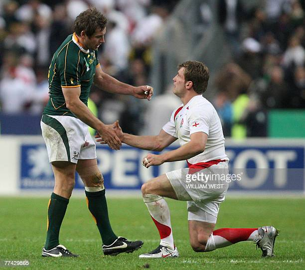 South Africa's flyhalf Butch James shakes hands with England's winger Mark Cueto after the rugby union World Cup final match England versus South...