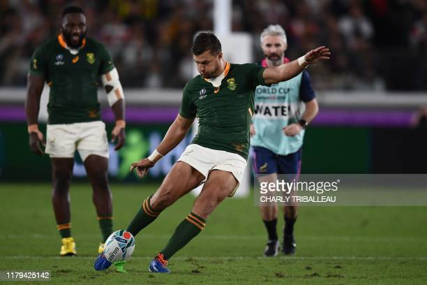 South Africa's flyhalf Handre Pollard kicks the ball during the Japan 2019 Rugby World Cup final match between England and South Africa at the...