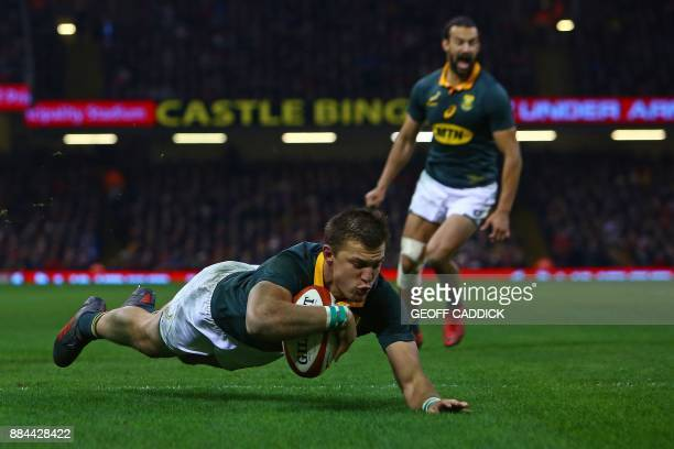 South Africa's flyhalf Handre Pollard scores his team's second try during the international rugby union test match between Wales and South Africa at...