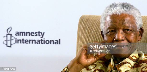 South Africa's former president Nelson Mandela poses after receving the Amnesty International 'Ambassador of Conscience' Award for 2006 in...