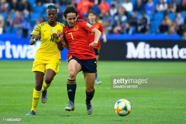 South Africa's forward Thembi Kgatlana vies for the ball with Spain's midfielder Marta Corredera during the France 2019 Women's World Cup Group B...