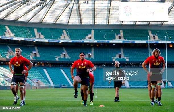 South Africa's forwards South Africa's lock PieterSteph du Toit South Africa's prop Wilco Louw and South Africa's lock RG Snyman warmup during the...