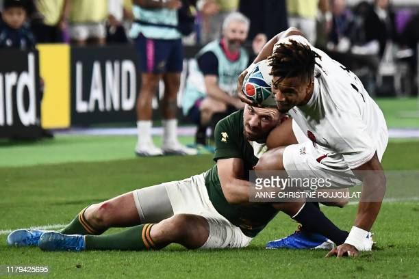 South Africa's full back Willie Le Roux tackles England's wing Anthony Watson during the Japan 2019 Rugby World Cup final match between England and...