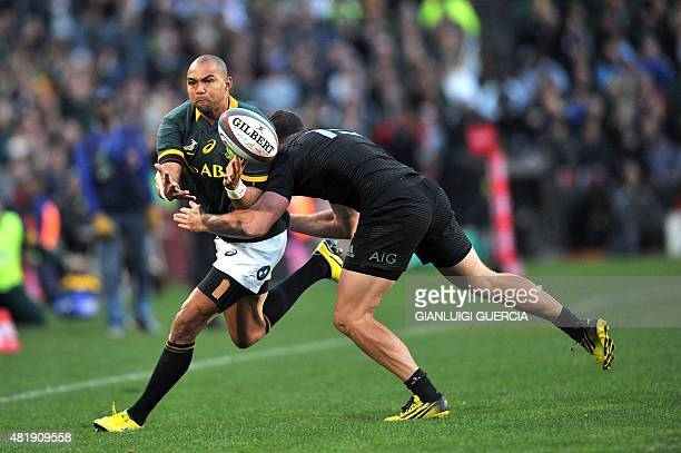South Africa's fullback Cornal Hendricks is tackled by a New Zealand player during their test match in Johannesburg on July 25 2015 AFP...
