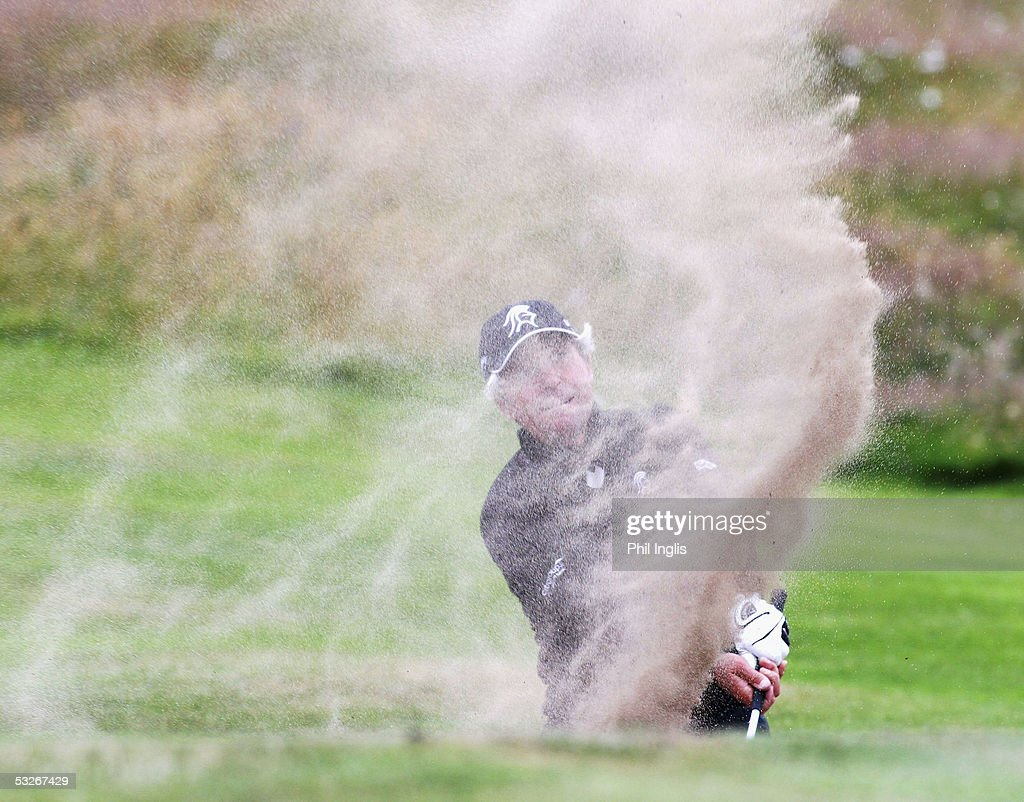 South Africa's Gary Player blasts out of the greenside bunker on the 17th hole during the first round of The Senior British Open Championship at the Royal Aberdeen Golf Club, Scotland, on July 21, 2005 in Aberdeen, Scotland.