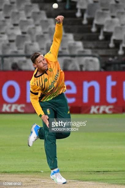 South Africa's George Linde delivers a ball during the first T20 international cricket match between South Africa and England at Newlands stadium in...