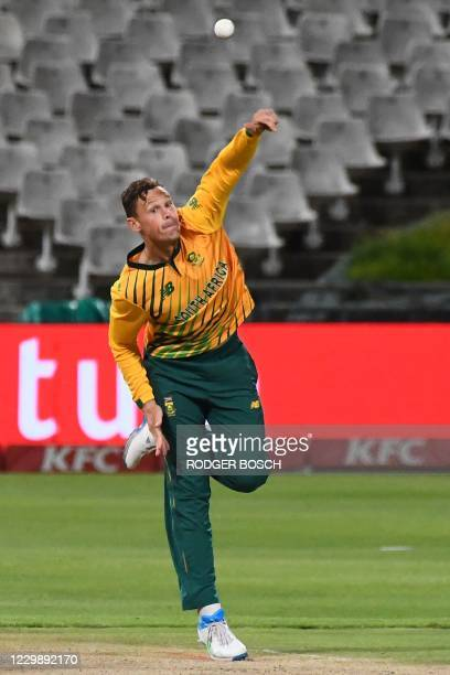 South Africa's George Linde delivers a ball during the third T20 international cricket match between South Africa and England at Newlands stadium in...