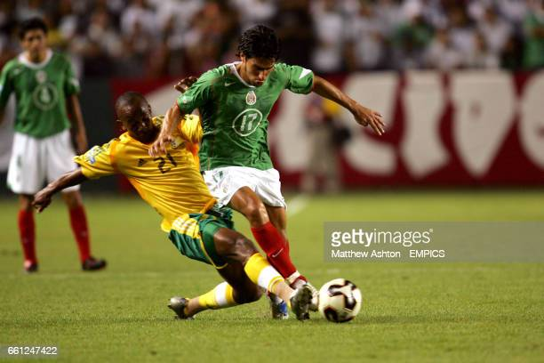 Gift leremi stock photos and pictures getty images south africas gift leremi tackles mexicos rafael marquez lugo negle Image collections