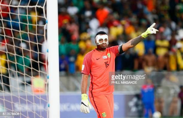 South Africa's goalkeeper and captain Itumeleng Khune gestures during the FIFA 2018 World Cup Africa Group D qualifying football match between South...