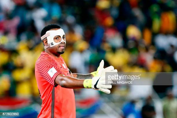 South Africa's goalkeeper Itumeleng Khune reacts during the FIFA 2018 World Cup Africa Group D qualifying football match between South Africa and...