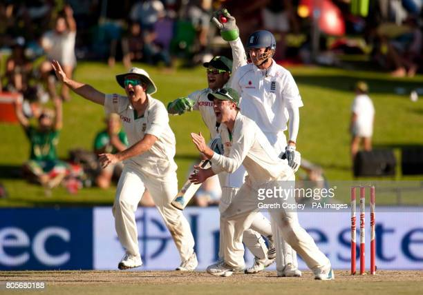 South Africa's Graeme Smith Mark Boucher and AB deVilliers celebrate dismissing England's Stuart Broad during the First Test at the SuperSport Park...