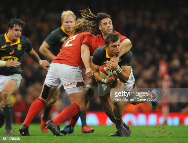 South Africa's Handre Pollard is tackled by Wales' Josh Navidi during the 2017 Under Armour Series Autumn International match between Wales and South...