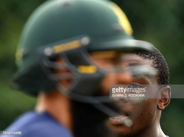 South Africa's Hashim Amla and Kagiso Rabada take part in a training session at the Pallekele International Cricket Stadium in Pallekele on August 4...