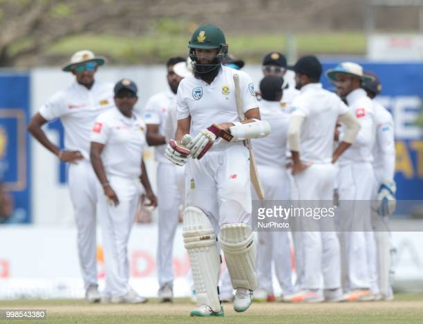 South Africa's Hashim Amla leaves following dismissal during the 3rd day's play in the first Test cricket match between Sri Lanka and South Africa at...
