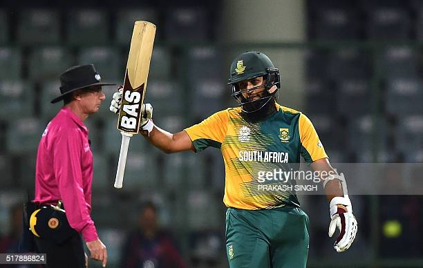 South Africa's Hashim Amla raises his bat after his half century during the World T20 cricket tournament match between South Africa and Sri Lanka at...