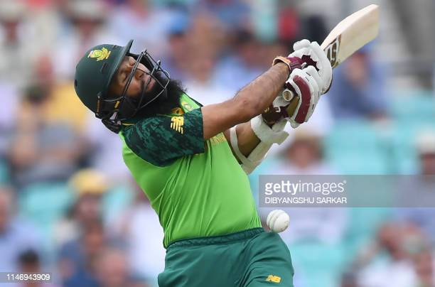 South Africa's Hashim Amla reacts as he is hit on the head by a delivery from England's Jofra Archer during the 2019 Cricket World Cup group stage...