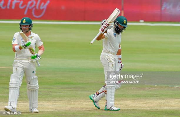 South Africa's Hashim Amla reactsafter scoring his fifty runs during day three of the 1st cricket test match between South Africa and Pakistan at...