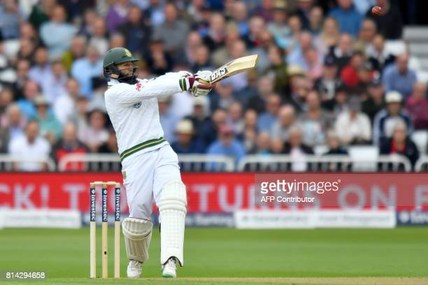 South Africa's Hasim Amla hits his 8,000th test run during play on the first day of the second Test Match between England and South Africa at Trent...