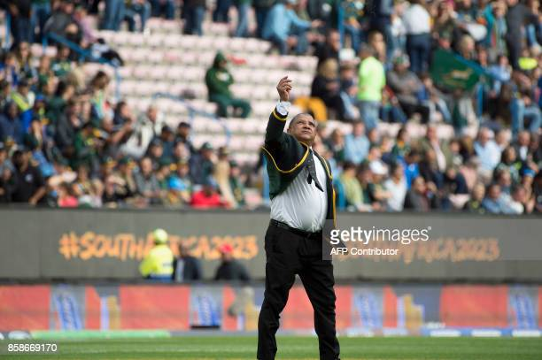 South Africa's head coach Allister Coetzee throws blades of grass in the air to test the wind prior to the Rugby test match between South Africa and...
