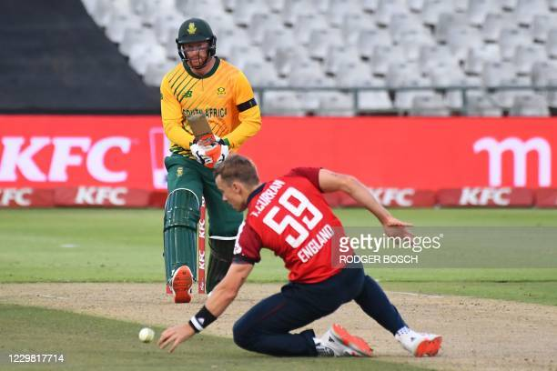 South Africa's Heinrich Klaasen looks on as England's Tom Curran attempts to catch the ball during the first T20 international cricket match between...