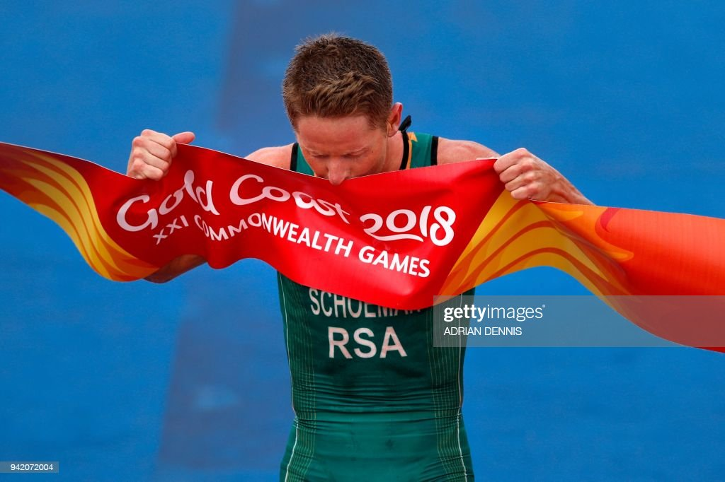 TOPSHOT - South Africa's Henri Schoeman celebrates winning the mens triathlon final during the 2018 Gold Coast Commonwealth Games at the Southport Broadwater Parklands venue in Gold Coast on April 5, 2018. /