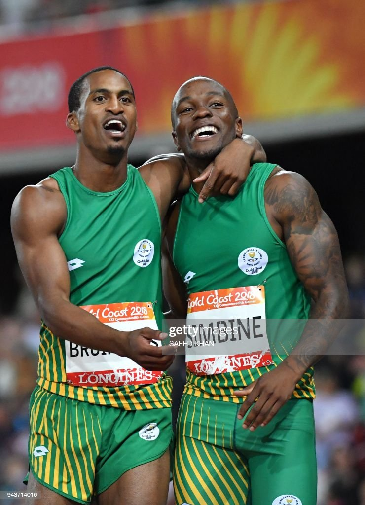 South Africas Henricho Bruintjies (silver) and South Africas Akani Simbine (gold) celebrate after the athletics men's 100m final during the 2018 Gold Coast Commonwealth Games at the Carrara Stadium on the Gold Coast on April 9, 2018. /
