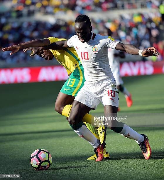 South Africa's Hlompho Kekana tackles Senegal's Sadio Mane during the 2018 World Cup qualifying football match between South Africa and Senegal on...