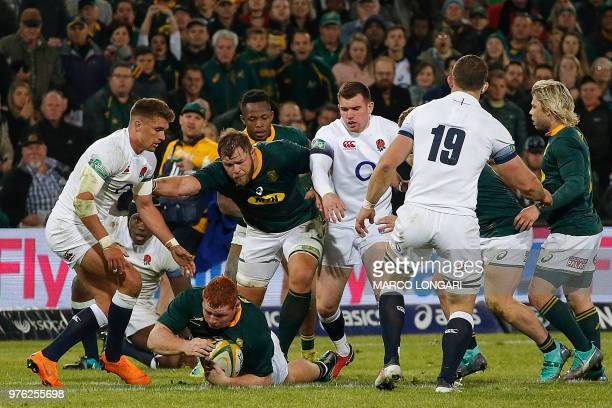 South Africa's hooker Akker van der Merwe protects South Africa's loose head prop Steven Kitshoff as he rolls with the ball during the second test...