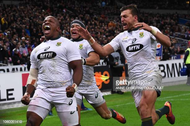 South Africa's hooker Bongi Mbonambi celebrates with South Africa's winger Cheslin Kolbe and South Africa's flyhalf Handre Pollard after scoring a...