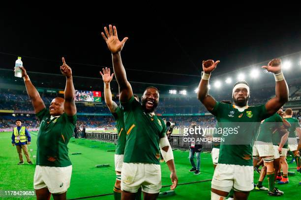 TOPSHOT South Africa's hooker Bongi Mbonambi South Africa's prop Tendai Mtawarira and South Africa's flanker Siya Kolisi celebrate winning the Japan...