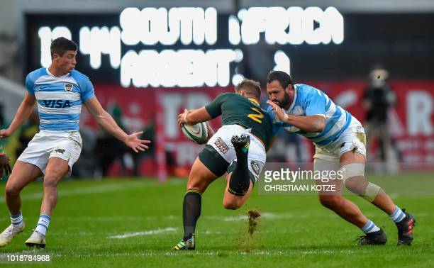 South Africa's hooker Malcolm Marx is tackled by Argentina's tighthead prop Juan Figallo during The Rugby Championship rugby union match between...