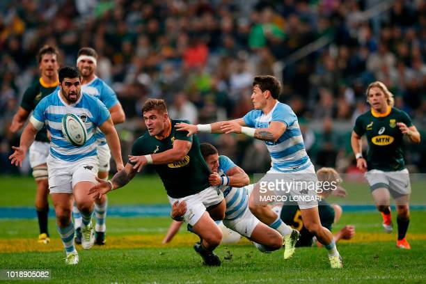 South Africa's hooker Malcolm Marx passes the ball as he is tackled during The Rugby Championship rugby union match between South Africa and...