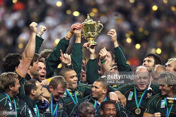 South Africa's hooker players celebrate with the William Webb Ellis cup after winning the rugby union World Cup final match England vs South Africa...