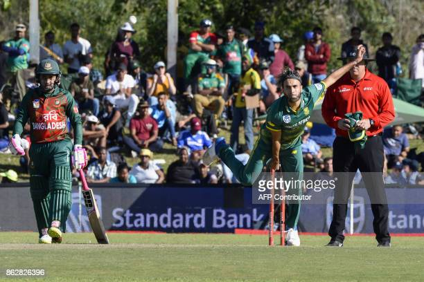 South Africa's Imran Tahir bowls during the second one day international cricket match between South Africa and Bangladesh at Boland Park in Paarl on...