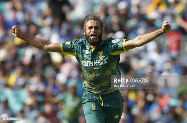 South Africas Imran Tahir celebrates taking the wicket of Sri Lankas Asela Gunaratne for four runs during the ICC Champions Trophy match between...