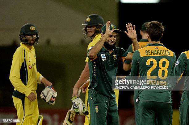 South Africa's Imran Tahir celebrates their win over Australia during a Oneday International cricket match between South Africa and Australia in the...