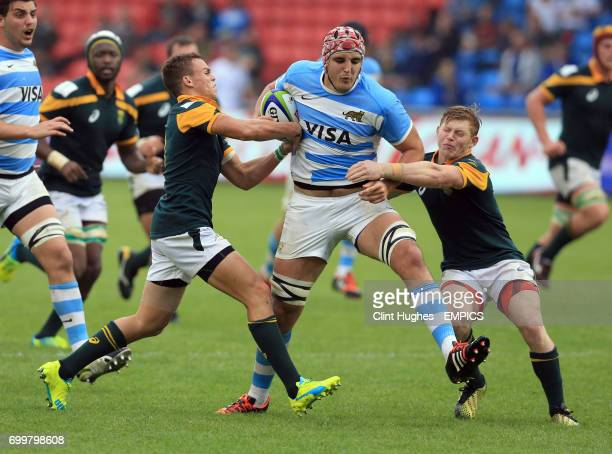 South Africa's James Hall and Curwin Bosch tackle Argentina's Franco Molina during the Under 20's Rugby Union World Cup match at the AJ Bell Stadium...