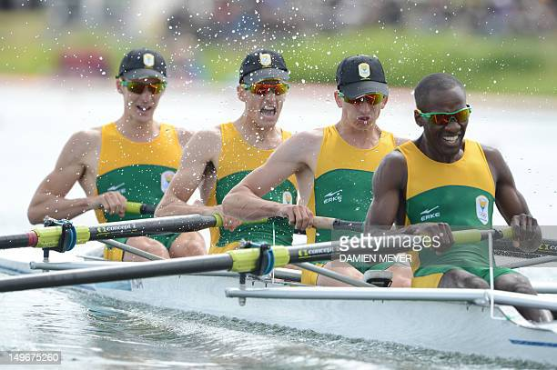 South Africa's James Thompson Matthew Brittain John Smith and Sizwe Ndlovu compete to win the gold medal in the men's lightweight four final A of the...