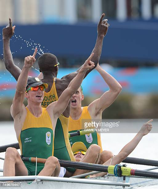 South Africa's James Thompson Matthew Brittain Sizwe Ndlovu and John Smith celebrate after winning the gold medal in the men's lightweight four final...