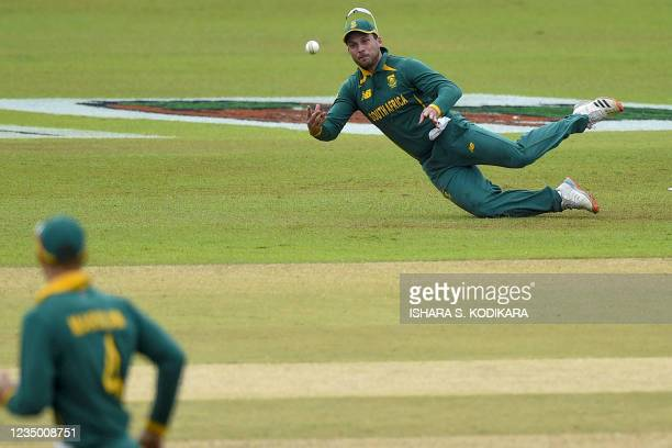 South Africa's Janneman Malan dives to stop the ball during the first one-day international cricket match between Sri Lanka and South Africa at the...