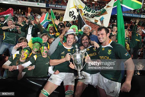 South Africa's Jean De Villiers Victor Matfield and Bismarck Du Plessis celebrate celebrate with the Tri Nations Cup following victory in their rugby...