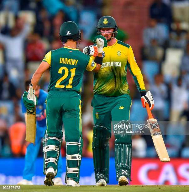 South Africa's JeanPaul Duminy congratulates South Africa's Heinrich Klaasen on his halfcentury during the second T20I cricket match between South...