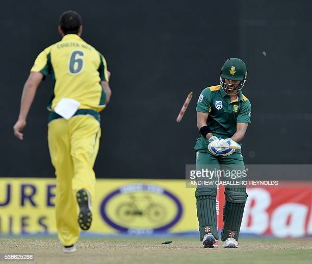 South Africa's JeanPaul Duminy is bowled by Australia's Nathan CoulterNile during a Oneday International cricket match between South Africa and...