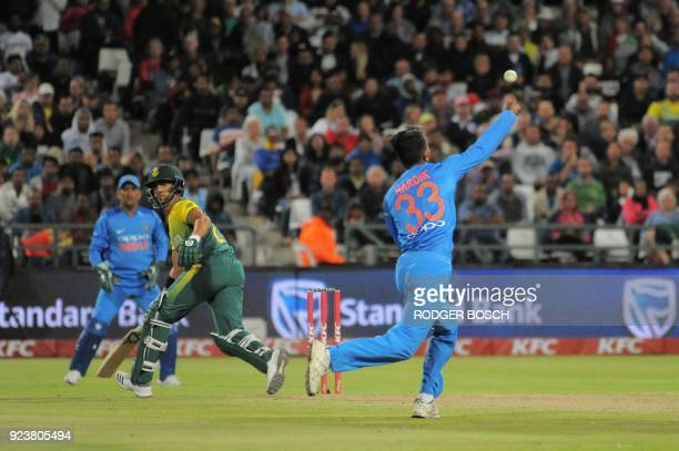 South Africa's JP Duminy hits a ball towards India's Hardik Pandya during the T20 cricket match against India vs South Africa at Newlands Stadium on...